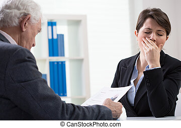 Yawning interviewer - Young female interviewer yawning on...