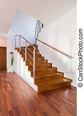 Wooden stairs in luxury house - Close-up of wooden stairs in...