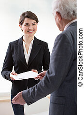 Woman with curriculum vitae - Young pretty woman on job...