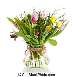 Tulips in vase isolated over white background