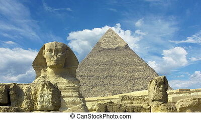Clouds over great pyramid and sphinx in Egypt - timelapse -...