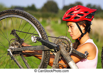 Mountain bike repair - Bike repair. Woman repairing mountain...