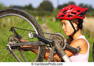 Mountain bike repair - Bike repair. Woman repairing mountain...