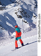 Snowboarder on the mountain slope
