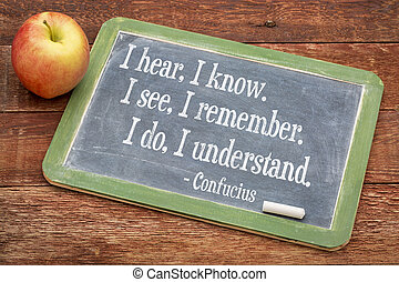 Confucius quote on balckboard - I hear, I know I see I...