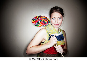 Cute Girl in Spotlight with Lollipop