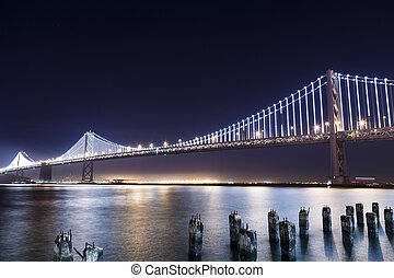SF-Oakland Bay Bridge at Night - San Francisco-Oakland Bay...