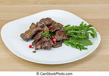 Roasted venison meat with ruccola and cranberries