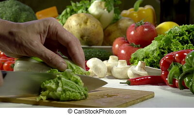 Cutting Chinese Cabbage - Hands cook cut into large yellow...