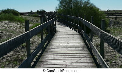 POV Walking on Wooden Walkway in the Sand Dunes, Portugal
