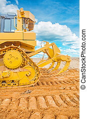 bulldozer ob sand rear vie with background sky