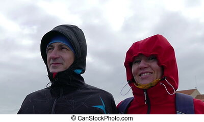Adult Couple Resist Hurricane Winds, closeup