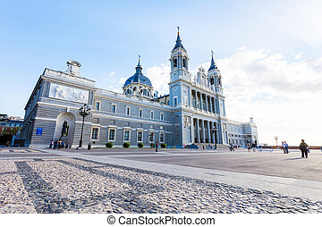 Cathedral Almudena with tourists on a spring day in Madrid -...