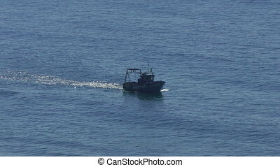 Fishing Boat Floating on the Ocean Waves, closeup