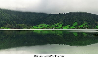 Fog Flow Over the Mountain and Lake in Volcano Crater,...