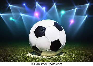 Soccer field with soccer ball, close up