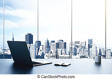 modern office with laptop and view to city