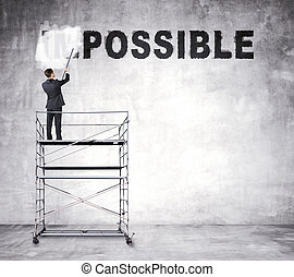 impossible - young businessman painting impossible text on...