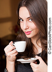Fresh coffee beauty - Portrait of a gorgeous young brunette...
