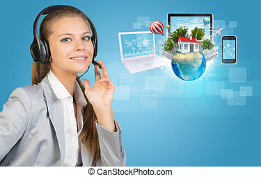 Businesswoman in headset, Globe, computers, smartphone and...