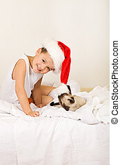 Boy with his cat waiting for christmas