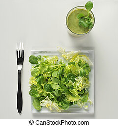 salad and green smoothie - high-angle shot of a plate with a...