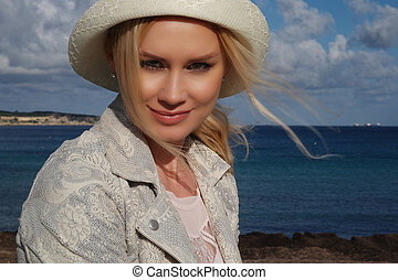 Pretty Young Woman at the Beach - Close up Portrait of...