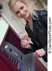 Woman Showing Withdrawn Money from the ATM - Close up...