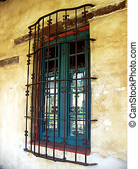 wrought iron window grill - Exterior window with decorative...