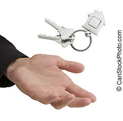 First time home buyer - Hand catching or tossing keys with...
