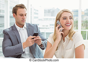 Business people using mobile - Young business people using...