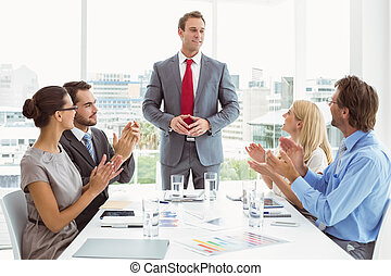 Business people clapping hands - Young business people...