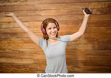 Dancing woman listening to music