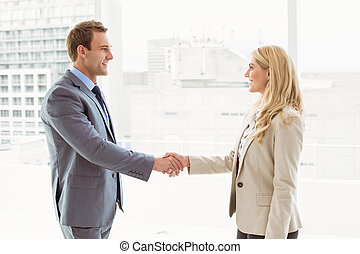 Executives shaking hands in office - Happy executives...