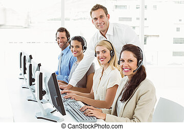 Business people with headsets - Portrait of young business...