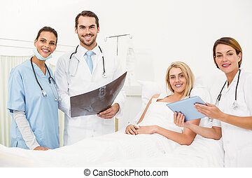 Portrait of doctors and patient with x-ray in the hospital