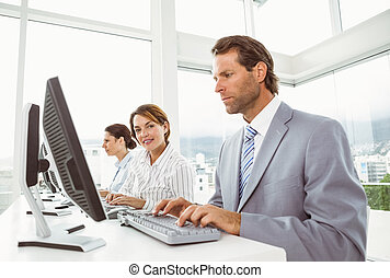 Business people with headsets - Side view of young business...