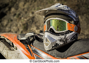 Dirty motorcycle motocross helmet with goggles - Offroad...