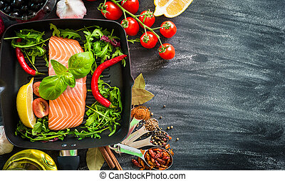 raw red fish with vegetables