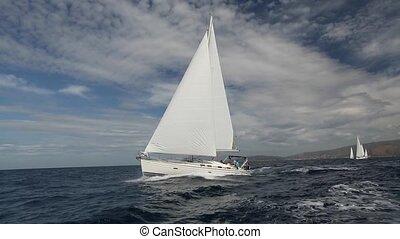 Luxury boat traveling on sea. Saili