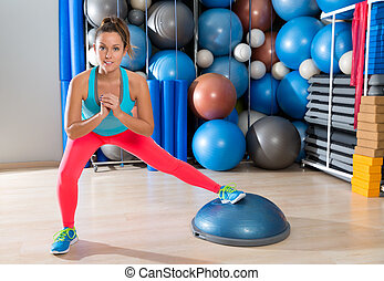 bosu one leg squat girl exercise at gym workout and swiss...