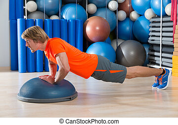 Bosu diamond push up blond man gym exercise - Bosu diamond...
