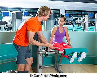 Gym leg extension workout woman personal trainer