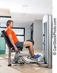 Hip abduction blond man exercise at gym closing - Hip...