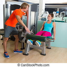 Leg extension exercise woman gym personal trainer
