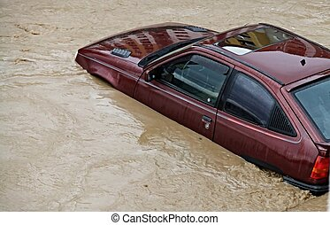 Flooded car - Car on a flooded street
