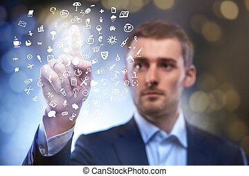 business man pressing button with set of icons in air