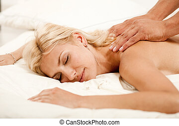 Beautiful woman getting a massage - Woman experiencing aroma...