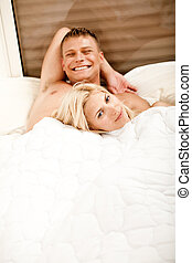 Smiling young couple relaxing