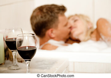 Couple kissing in the bath - Guy and female kissing in...